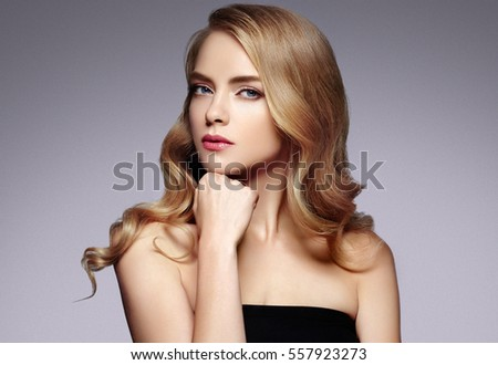Blond Hair Woman. Beautiful Sexy Blonde Girl. Beauty isolated on a Color Background
