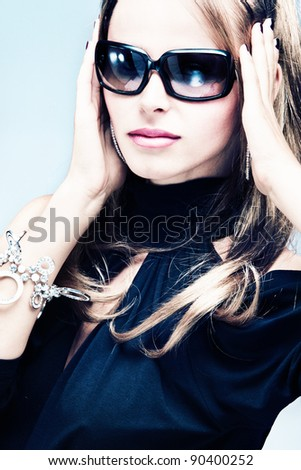blond woman with sunglasses portrait, studio shot