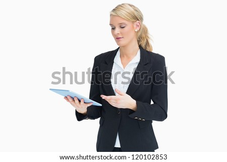 Blonde businesswoman with her tablet