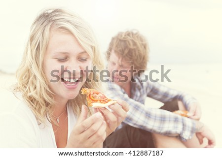 Blonde Girl Eating Pizza Beach Concept