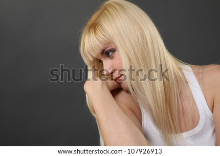 blonde girl in white pensive