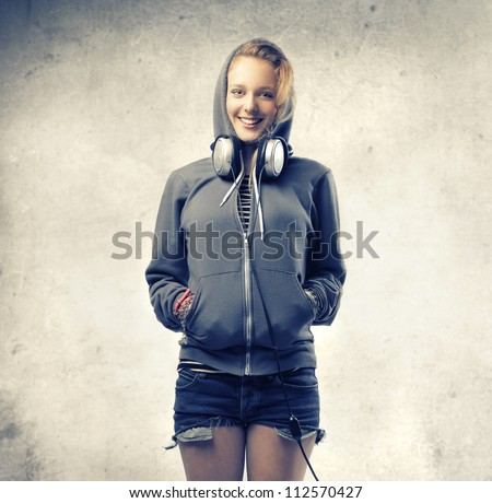 Hoodie with headphones in hood