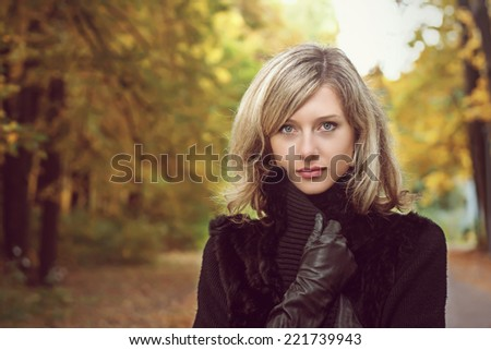 Blonde is in the park in autumn