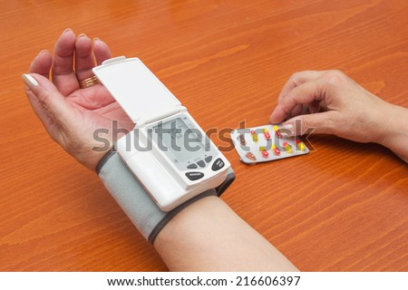 Blood Pressure Meter on Adult Woman Wrist.