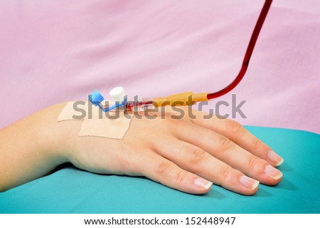 Blood transfusion solution in a patients hand