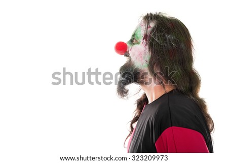 bloody clown in a face profile looking at a copyspace, isolated on white, concept halloween