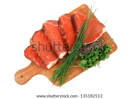 bloody raw beef meat on wooden plate with chives and thyme isolated on ...