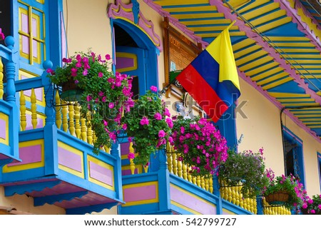 blooming flowers on colonial style balcony in Filandia Colombia
