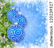 Blue and silver christmas decoration baubles and pine on blue background - stock photo