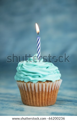 blue birthday cake with candle part cake on a white