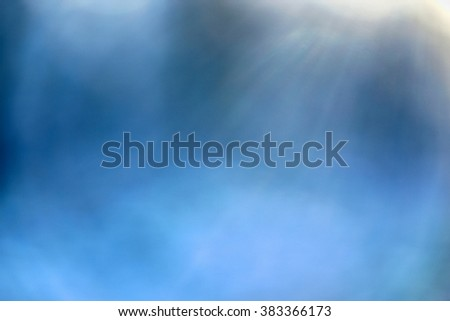 blue blur background with white spots