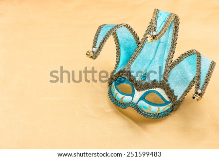 Blue carnival mask harlequin. Holidays background. Symbol of venetian mask festival.
