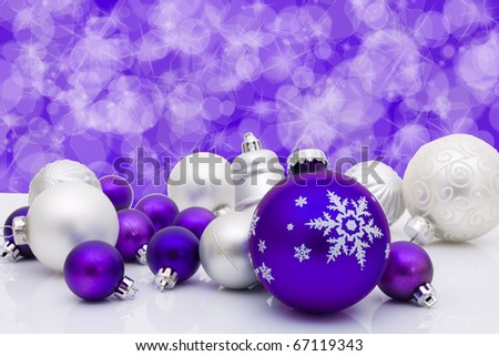 Blue christmas balls and bells on a blue background, christmas time