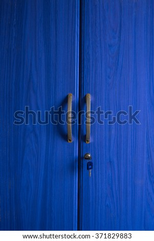 Blue color wooden door closets with handle and key