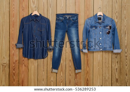 Blue denim jean and jeans shirt ,jacket on wooden background