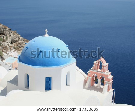 Blue domes and bells of a Greek Orthodox church in Oia, Santorini,