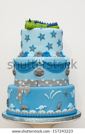 Blue dragon cake on a white background