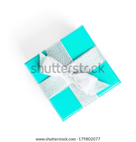 Blue gift box with silver ribbon. Isolated on white background. View from above