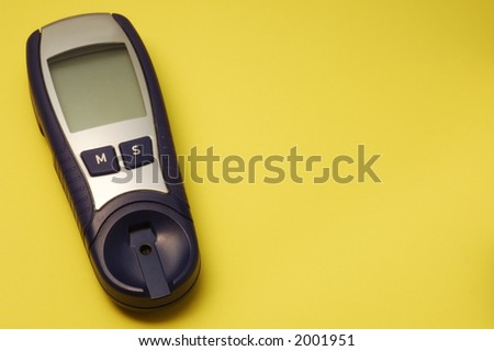 blue glucose meter on yellow background