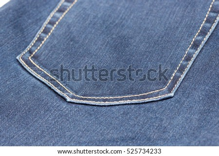 Blue jean or denim on wooden desk,old jean background