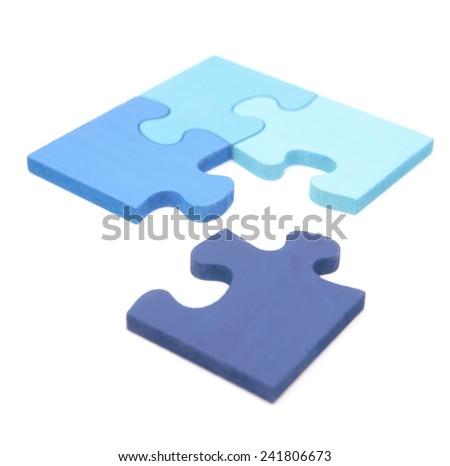 Blue jigsaw puzzle with a final piece going into place on white background
