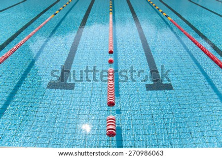 Blue line of lane in clear swimming pool