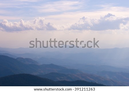 Blue mountain view with clouds and fog