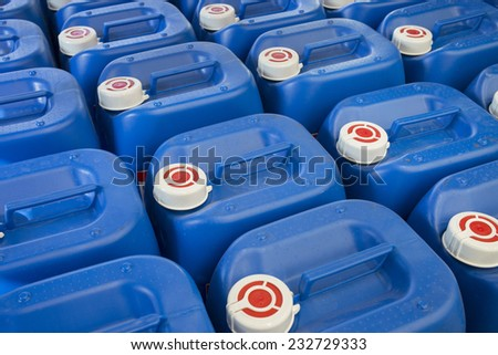 Blue plastic barrels containing chemicals in storage