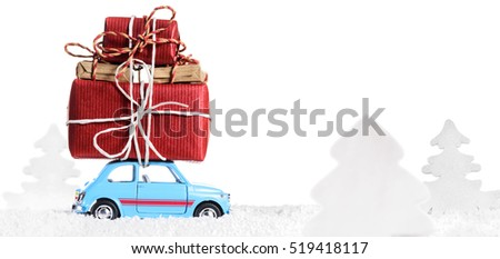 Blue retro toy car delivering Christmas or New Year gifts, isolated on white