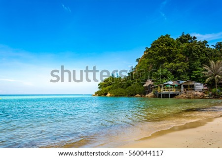 Blue sea and a moving reflection of sunlight . White sandy beach on vacation