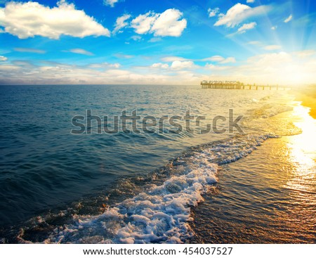 Blue sea and sun on sunset