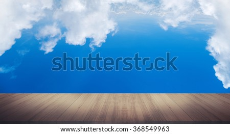 blue sky with clouds and wood planks floor background