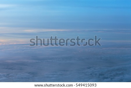 Blue sky with white puffy clouds. View from the plane. Sky from illuminator.