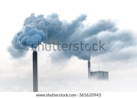 Blue smoke from chimneys of power plant