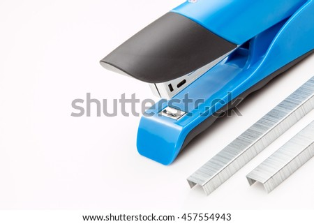 Blue stapler with staples on a white background.