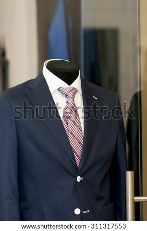 blue suit  on a mannequin in a shop.