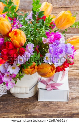 blue, violet  and red freesia and range tulip flowers