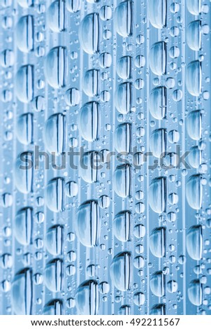 Blue water drops of on treat water-repellent surface in macro lens shot small-DOF for screen wallpapers