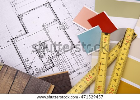 Blueprint of a house with folding ruler on top
