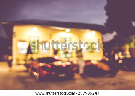 Blur background :Outdoor home at night with bokeh light.