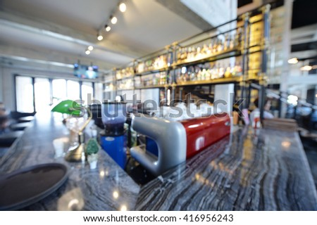 Blur coffee shop or cafe restaurant with abstract bokeh light image background. For create montage product display