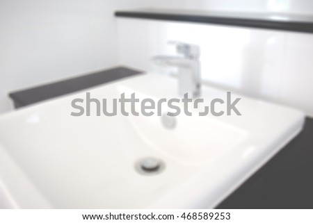 Blur image of Modern washbasin in bathroom  close up background.
