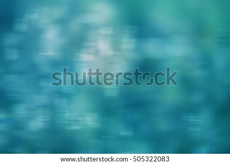 Blurred abstract background in shades of dark blue, green and white