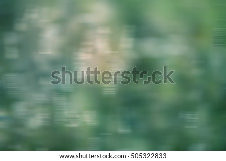 Blurred abstract background in shades of green,yellow and white