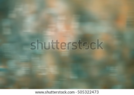 Blurred abstract background in shapes of green, blue, yellow and white