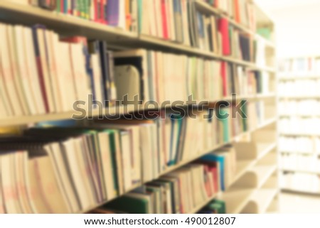 Blurred abstract background of book shelves row and interior of college library with library textbooks,library literature,library menuscript, library thesis and library magazines. - Vintage Tone.