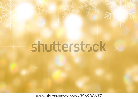 Blurred abstract background of magical sparkling shimmering gold color chandelier lamp bokeh light winter snowflake pattern with copy space : Happy new year seasonal holiday greeting backdrop design