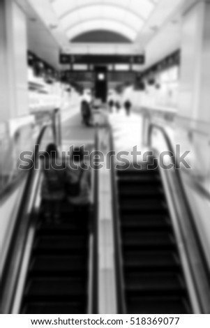 Blurred abstract background of People using the escalator