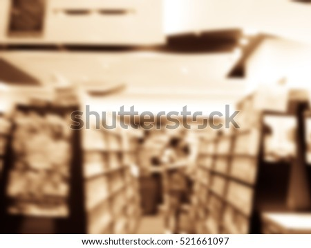 Blurred abstract background of public library interior with aisle of bookshelf with textbooks, literature, seating for students and faculties for reading. Self-study, educational concept/background