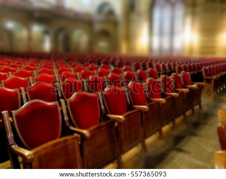 Blurred background image. The interior of the theater arts. The auditorium with seats chairs